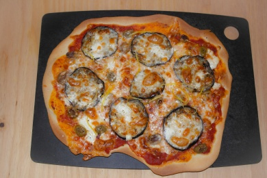 Aubergine, goats cheese and olive pizza