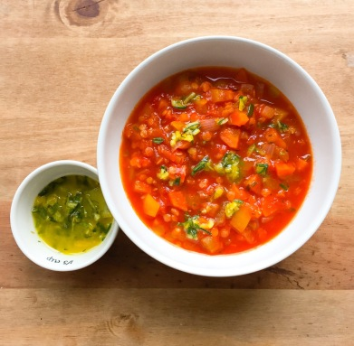 Tomato and red lentil soup with lemon and rosemary oil